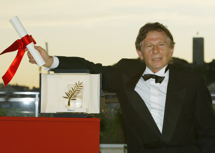 "405848 14: French director Roman Polanski holds his Palme d''Or (Golden Palm) award at the 55th Cannes Film Festival May 26, 2002 in Cannes, France. Polanski won the award for the film ""The Pianist,"" which is a story of one man's survival in the Warsaw ghetto during World War Two. (Photo by Pascal Le Segretain/Getty Images)"