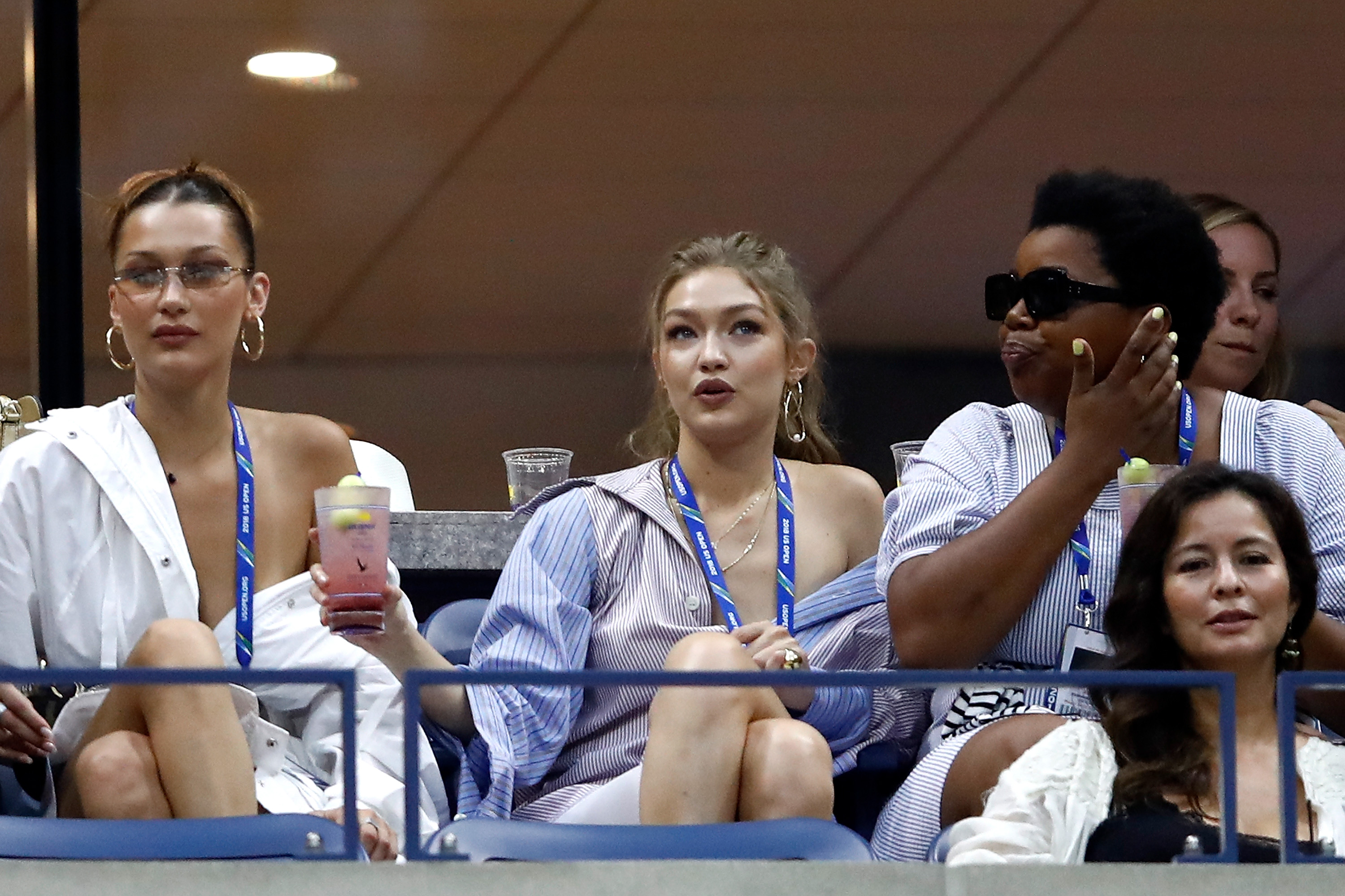 NEW YORK, NY - SEPTEMBER 04: Gigi Hadid and Bella Hadid watch on during the women's singles quarter-final match between Serena Williams of The United States and Karolina Pliskova of Czech Republic on Day Nine of the 2018 US Open at the USTA Billie Jean King National Tennis Center on September 4, 2018 in the Flushing neighborhood of the Queens borough of New York City. (Photo by Julian Finney/Getty Images)