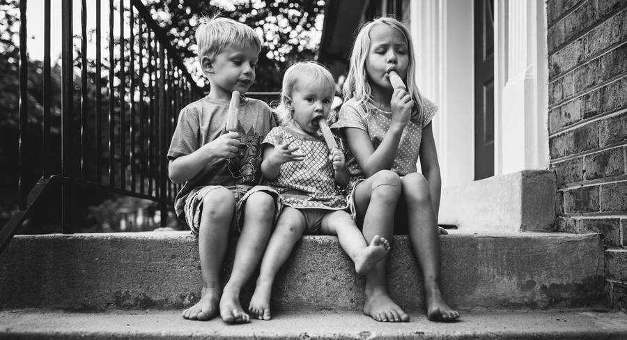 Kids eating popsicles on steps