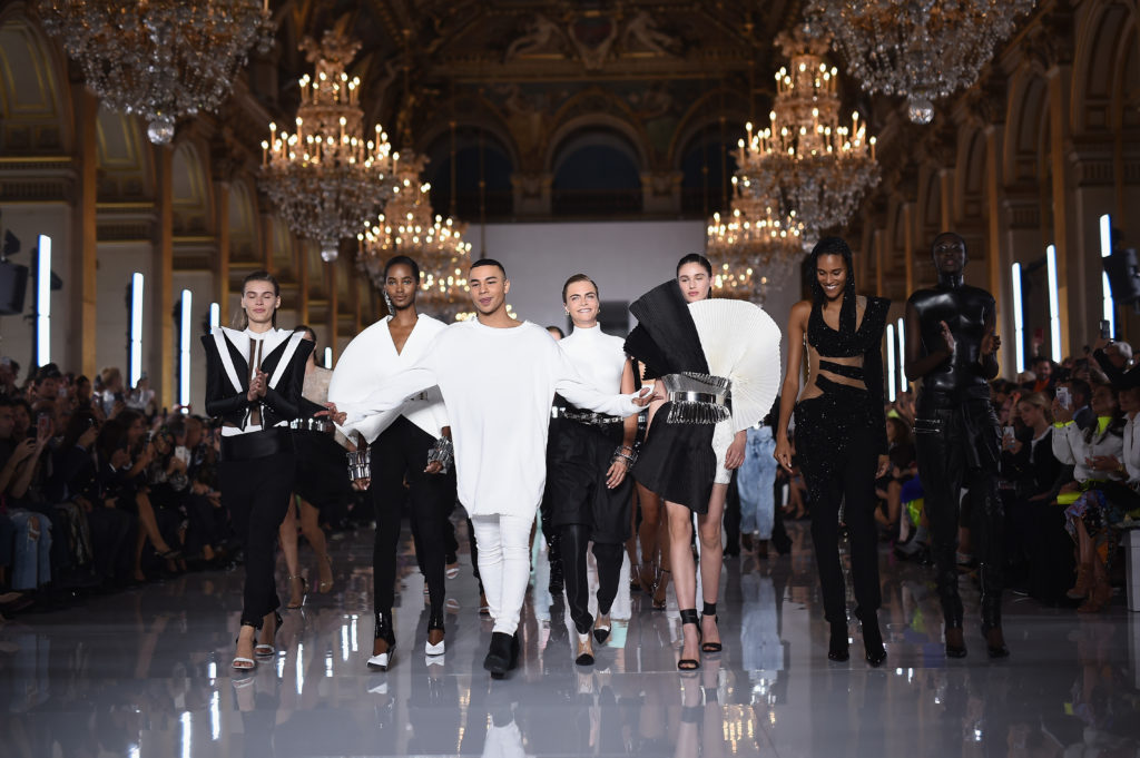 PARIS, FRANCE - SEPTEMBER 28:  Designer Olivier Rousteing (3rdL) and model Cara Delevingne (C) are applauded on the runway during the Balmain show as part of the Paris Fashion Week Womenswear Spring/Summer 2019 on September 28, 2018 in Paris, France.  (Photo by Pascal Le Segretain/Getty Images)