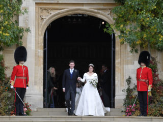 WINDSOR, ENGLAND - OCTOBER 12: Princess Eugenie of York of York and her husband Jack Brooksbank leave after their wedding at St George's Chapel in Windsor Castle on October 12, 2018 in Windsor, England. (Photo by Toby Melville - WPA Pool/Getty Images)