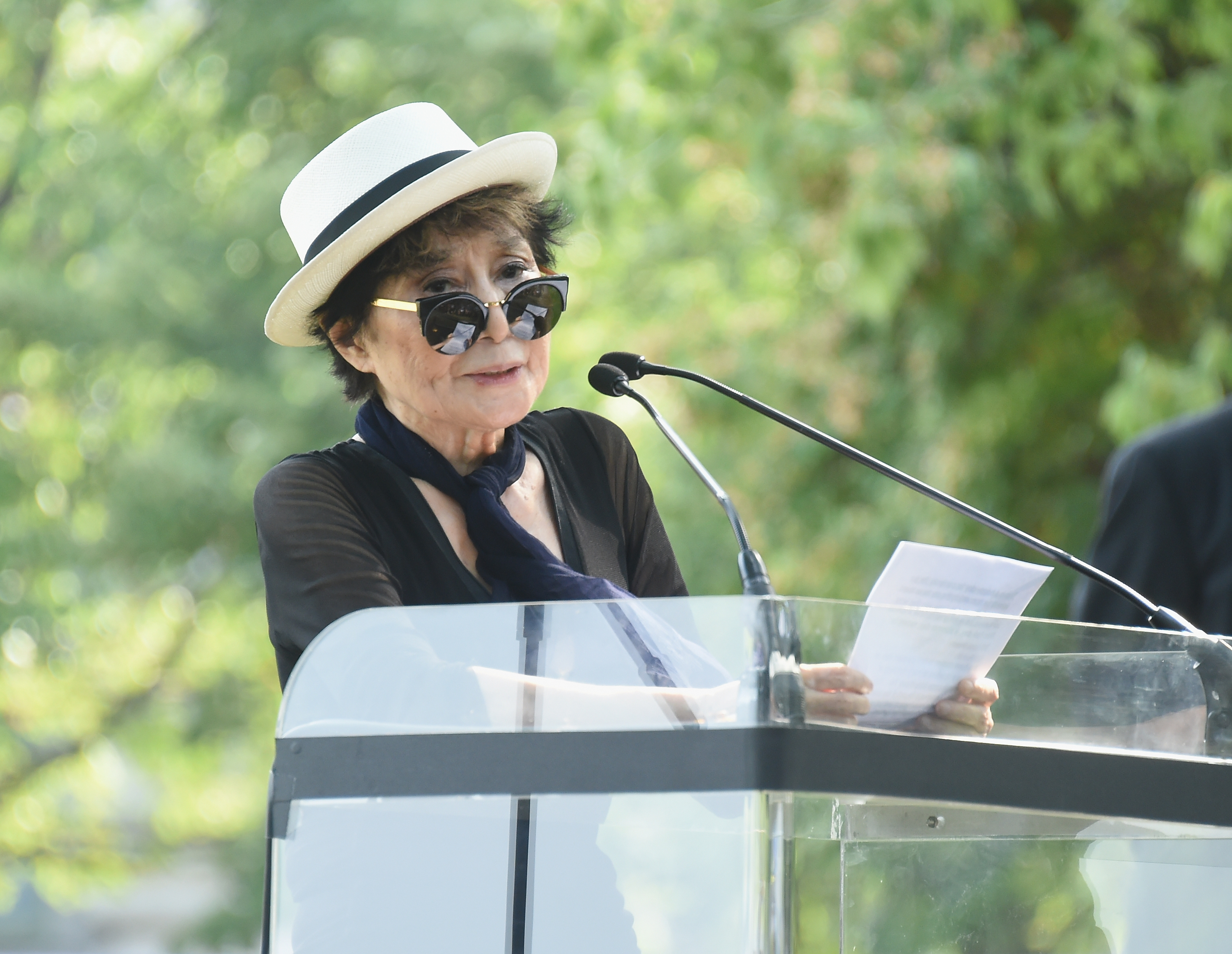 NEW YORK, NY - JULY 29:  Yoko Ono speaks at Amnesty International Tapestry Honoring John Lennon Unveiling at Ellis Island on July 29, 2015 in New York City.  (Photo by Jamie McCarthy/Getty Images)