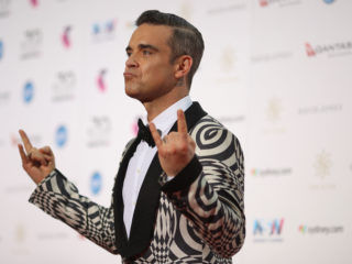 SYDNEY, AUSTRALIA - NOVEMBER 23:  Robbie Williams arrives for the 30th Annual ARIA Awards 2016 at The Star on November 23, 2016 in Sydney, Australia.  (Photo by Cameron Spencer/Getty Images)
