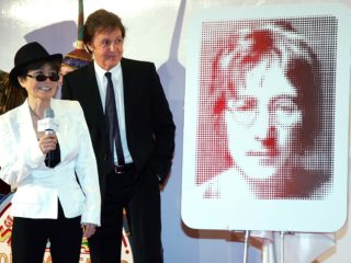 "LAS VEGAS - JUNE 26:  (L-R) Yoko Ono and Sir Paul McCartney stand next to a plaque of John Lennon during a dedication ceremony for the plaque and one for George Harrison as part of the first anniversary celebration of ""The Beatles LOVE by Cirque du Soleil"" show at The Mirage Hotel & Casino June 26, 2007 in Las Vegas, Nevada.  (Photo by Ethan Miller/Getty Images)"