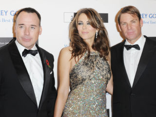 LONDON, UNITED KINGDOM - NOVEMBER 10: David Furnish, Elizabeth Hurley and Shane Warne attend the Grey Goose Winter Ball at Battersea Power station on November 10, 2012 in London, England. (Photo by Stuart Wilson/Getty Images)