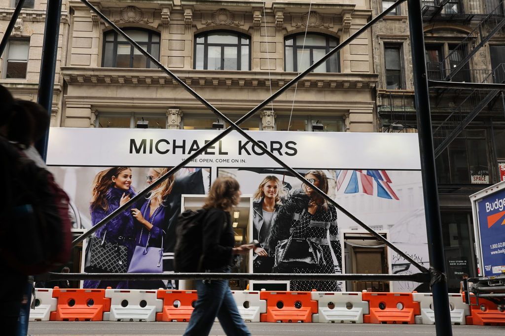 NEW YORK, NY - JULY 25:  A Michael Kors store stands in lower Manhattan on July 25, 2017 in New York City. Michael Kors Holdings announced on Tuesday that it had agreed to buy the shoe company Jimmy Choo for 896 million pounds, or about $1.2 billion. As retail sales across the country continue to weaken, many companies are starting to search for new sources of growth, especially in more luxury brand markets.  (Photo by Spencer Platt/Getty Images)