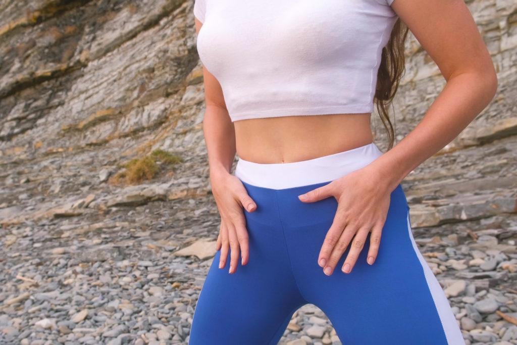 Flat belly girl during breathing exercises body flex