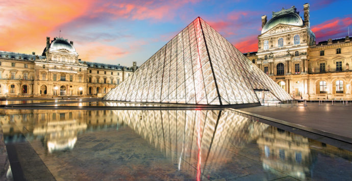 Paris, France - February 7, 2015: Louvre museum at dusk on February 7, 2015 in Paris. This is one of the most popular tourist destinations in France displayed over 60,000 square meters of exhibition space.