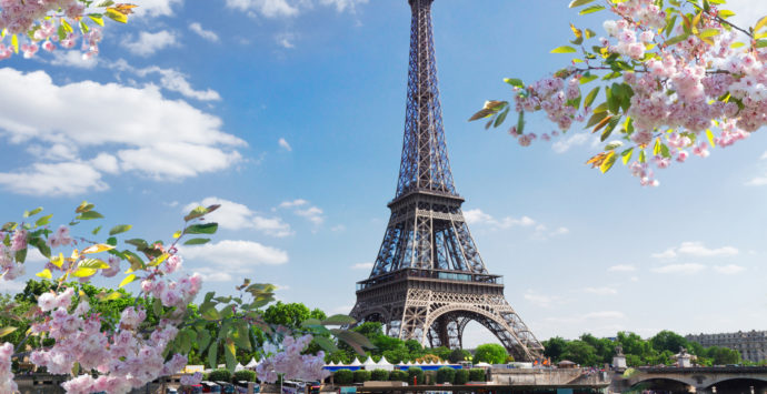 eiffel tour over Seine river waters at spring day, Paris, France