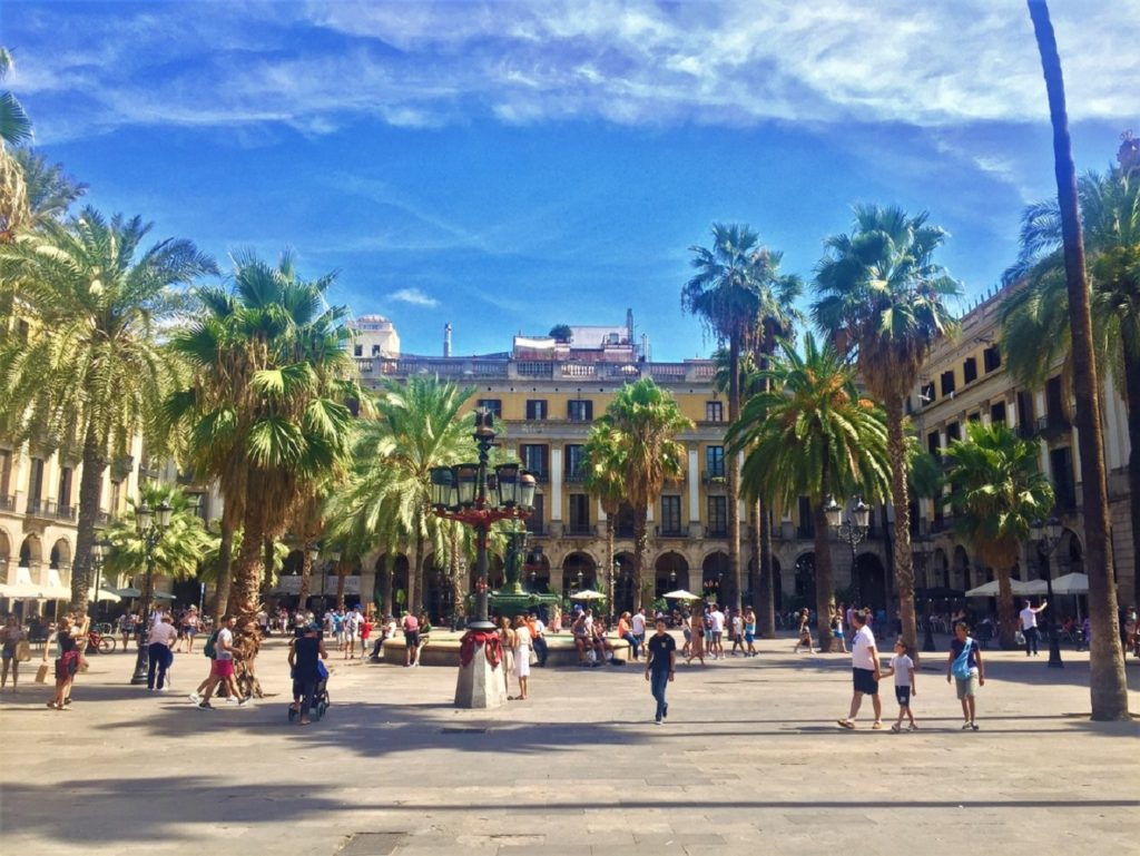 Barcelona, Spain - 13th August 2017: Locals and tourists enjoy the sunshine in a city square of Barcelona