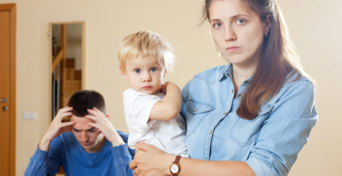 Family of three with child having conflict