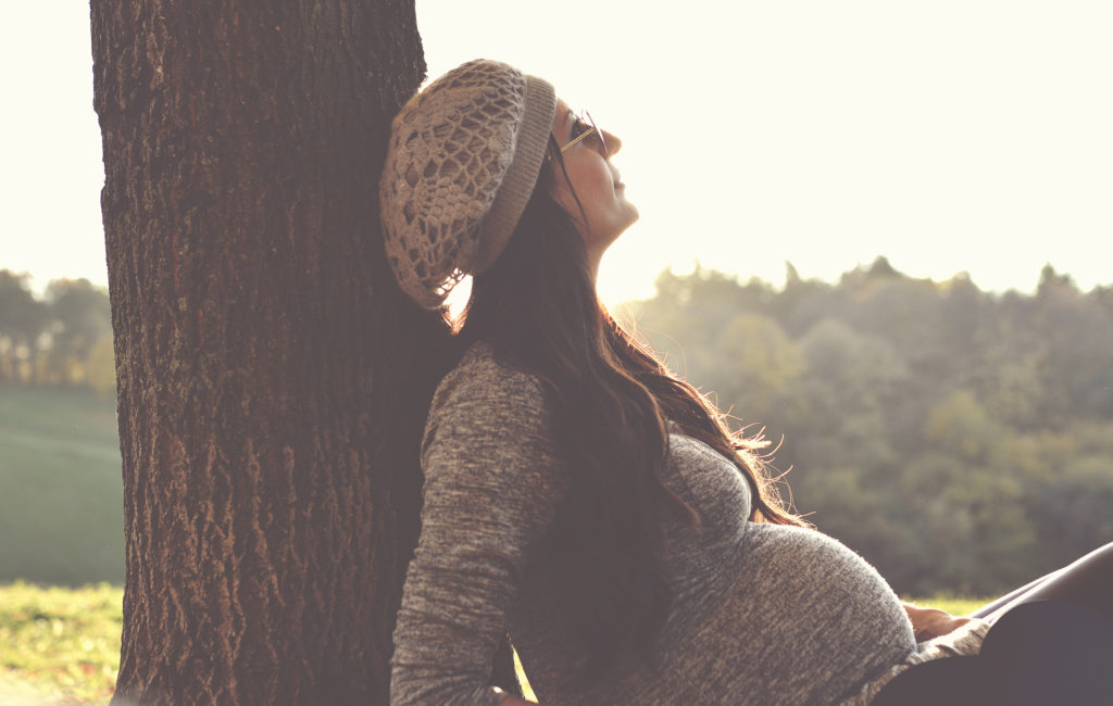 Waiting for baby, coming soon, Pregnant woman in the autumn park