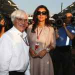 ABU DHABI, UNITED ARAB EMIRATES - NOVEMBER 04:  F1 supremo Bernie Ecclestone and his wife Fabiana Flosi are seen on the grid before the Abu Dhabi Formula One Grand Prix at the Yas Marina Circuit on November 4, 2012 in Abu Dhabi, United Arab Emirates.  (Photo by Mark Thompson/Getty Images)