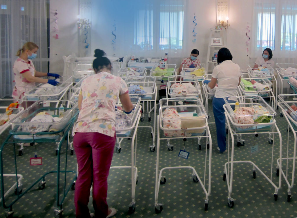 """10 June 2020, Ukraine, Kiew: In a hotel on the outskirts of the city, dozens of surrogate babies have been waiting to be picked up by their foreign biological parents since mid-March because of the borders closed during the coronavirus quarantine. In Ukraine, dozens of surrogate mother babies still cannot be picked up by their foreign parents due to corona restrictions. (to dpa """"Corona: Dozens of uncollected surrogate mother babies in Ukraine"""") Photo: Andreas Stein/dpa (Photo by Andreas Stein/picture alliance via Getty Images)"""