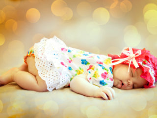 Portrait of a beautiful sleeping baby. Soft focus.