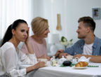 Mother-in-law and son talking and ignoring girlfriend, unhealthy relations