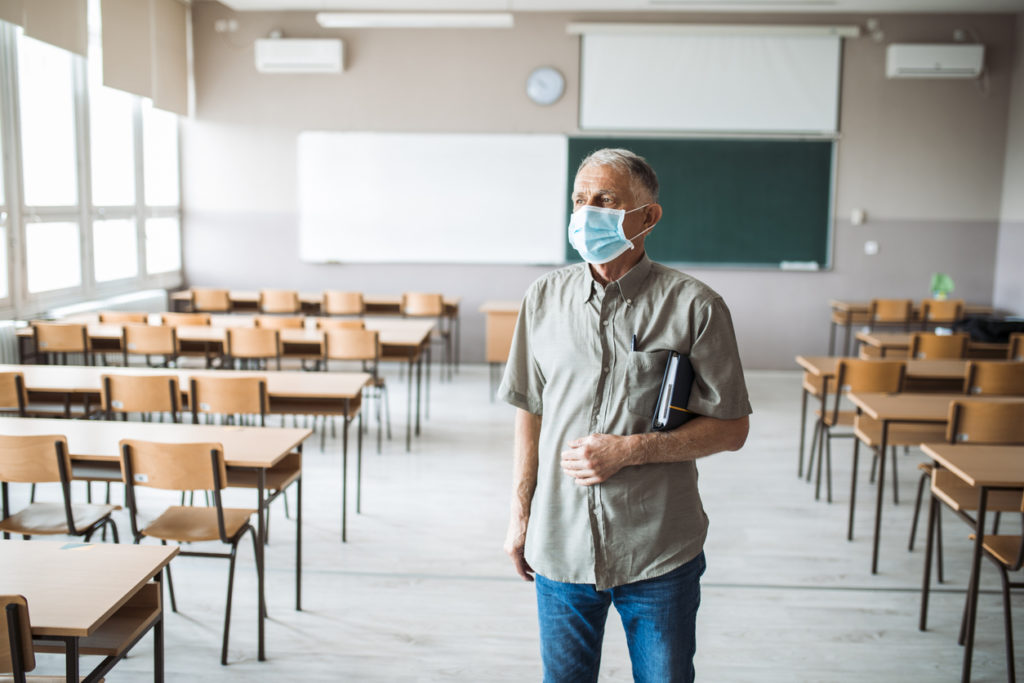 Teacher in an empty classroom during corona virus crisis