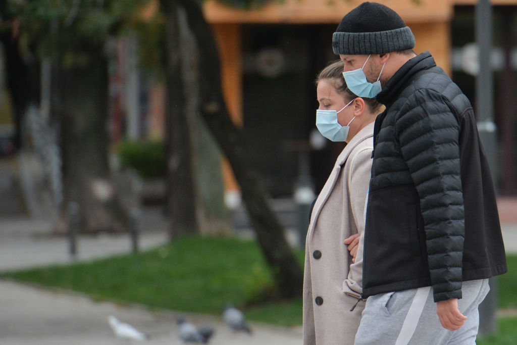 People wearing protective masks on the street in Sofia center. The number of people infected with COVID-19 in Bulgaria is increasing, with the highest number of new COVID cases recorded three days in a row. The Ministry of Health today reported 516 new cases, a new daily record of new cases, and 7 deaths. On Friday, October 9, 2020, in Sofia, Bulgaria. (Photo by Artur Widak/NurPhoto via Getty Images)