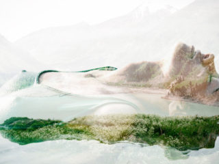 Double exposure portrait of seductive woman combined with photograph of lake surrounded with mountains. Add some creativity to your project!