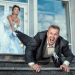 Bride leg pulls groom at the wedding.