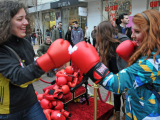 SOFIA, BULGARIA - MARCH 8:  Bulgarian women wear boxing gloves during the celebration of International Womens Day in the capital Sofia, Bulgaria on March 8, 2014. Bulgarians mark out to international awareness and stop rape, sexual assault and gender violence. (Photo by Ihvan Radoykov/Anadolu Agency/Getty Images)