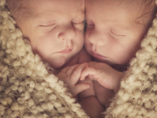 Twins and newborn and shape of heart