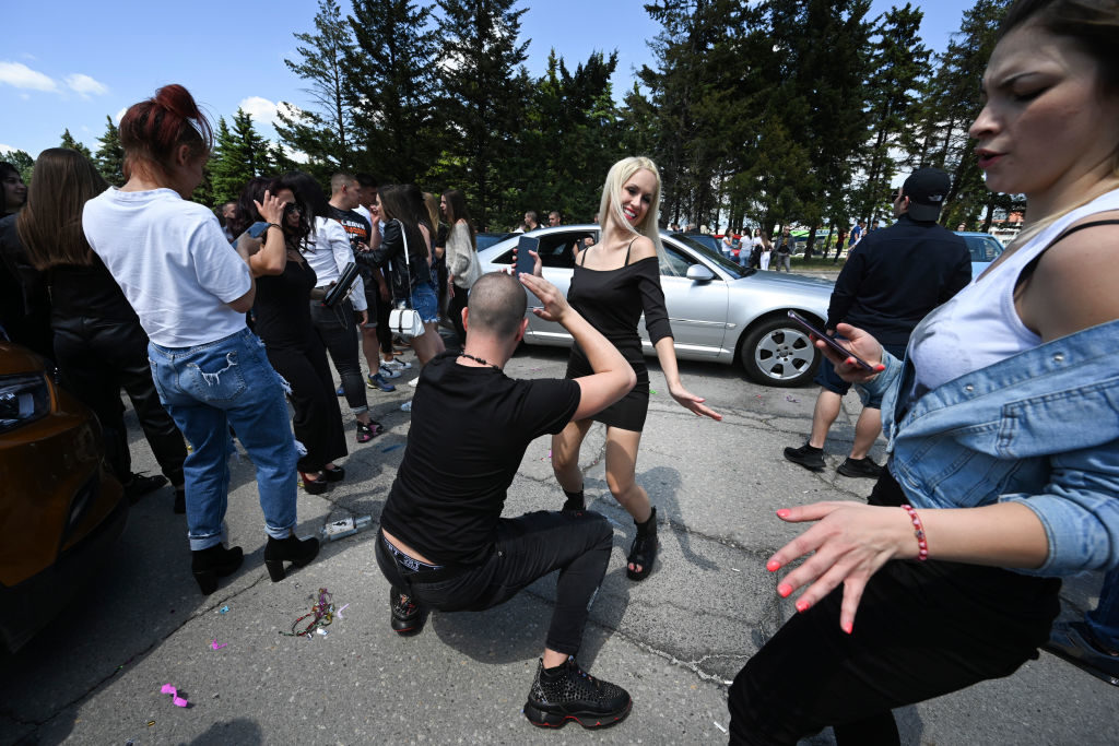 Despite having their graduation ceremonies cancelled due to the coronavirus epidemic, high school graduates celebrated by meeting in a parking lot on the outskirts of Sofia, Bulgaria  on Saturday, May 23. Since Bulgaria ended its COVID-19 emergency measures, Bulgarians have begun gathering publicly. Thus far, cases of coronavirus in Bulgaria appear to be significantly less than in other European countries. (Photo by Jodi Hilton/NurPhoto via Getty Images)