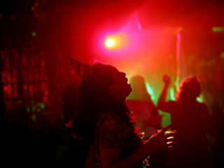 WASHINGTON, DC - JUNE 11: Patrons dance at DC9 nightclub during their Lost Birthday Club dance party on June 11, 2021 in Washington, DC.  Washington, D.C. lifted pandemic capacity limits for bars, nightclubs and music venues allowing for full capacity. (Photo by Kevin Dietsch/Getty Images)