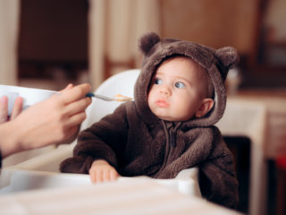 Small infant being a picky eater disliking the food